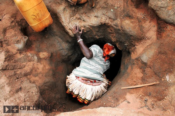 A woman collecting water.
